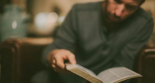 Here is a man reading a book